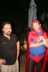 At Russell's 50th birthday party, taking a break from dancing, standing next to Superman.